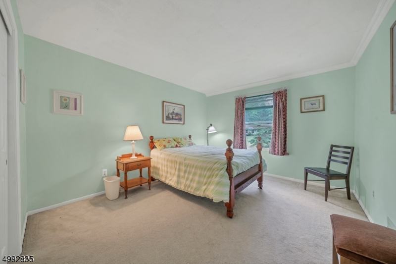 Two additional bedrooms are on the second level both with carpeting and a double closet.
