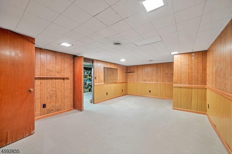 A walk-out Bilco door basement with laundry area is ready for all your finishing touches.