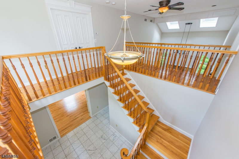 Fresh paint, open space & hardwood floors upstairs overlooking the family room & open to the foyer.