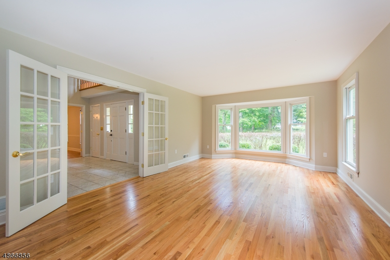 Tons of natural light, french doors, all new hardwood floor & freshly painted.