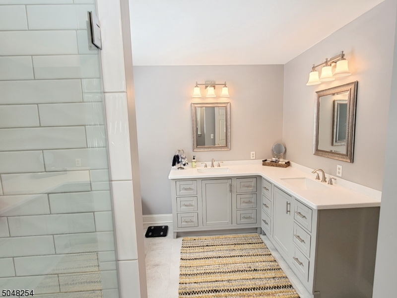Renovated bath with double sinks and large stall shower