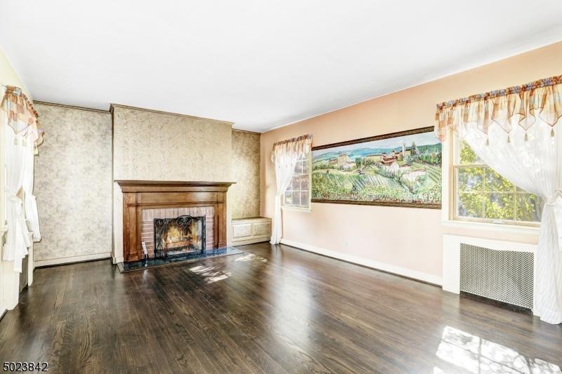 Wood floors, wood-burning fireplace.
