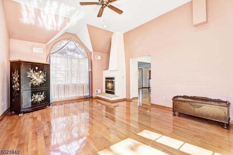 High ceiling, wood floors, palladium window, see-through gas fireplace.