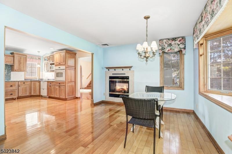 Wood floors, bay window, two sided gas fireplace.