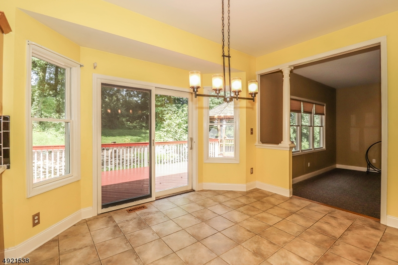 Opens to Kitchen and Family Room