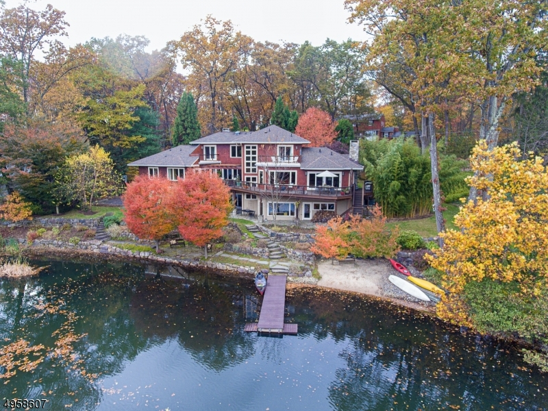 Nestled on a prime lot on sought after Crystal Lake, this newer home is steps from the town Park and Tourne County parklands offering over 500 acres of walking trails and parklands