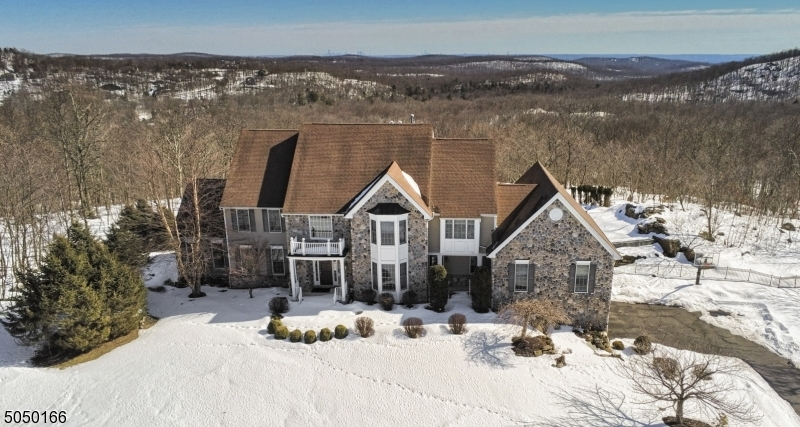 This home has everything! NYC skyline, mountain views, pool, in-law area, home office, exercise room, media room and acreage! Five bedrooms and five and half baths. Finished basement. Three car garage.