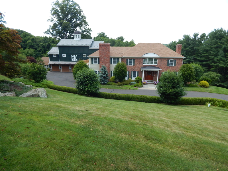 Luscious 3 acres of professional landscaping and privacy in Washington Valley
