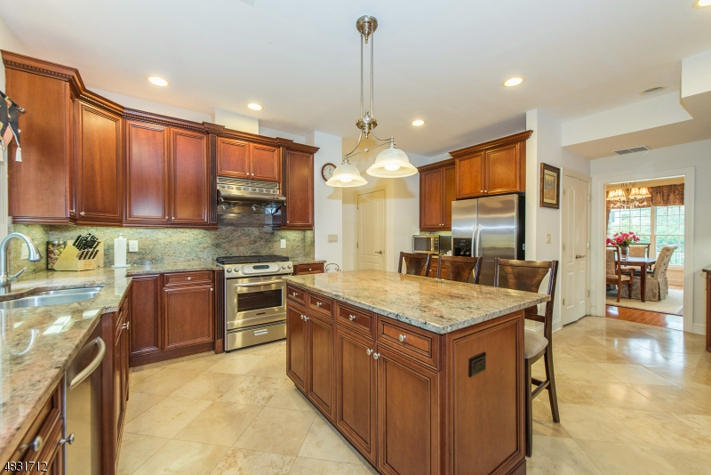 This view shows the beauty of the cherry cabinets and the granite counters!