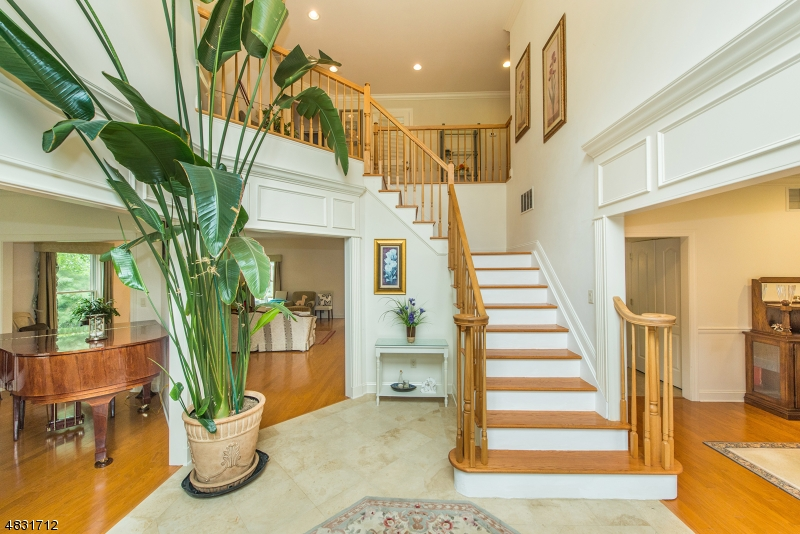 As you enter this stunning two-story foyer you'll see the beauty of this perfect open floor plan!