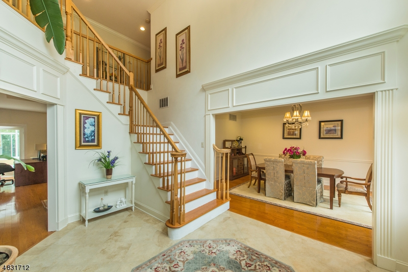 This stunning two-story foyer opens into the dining room, living room and family room!
