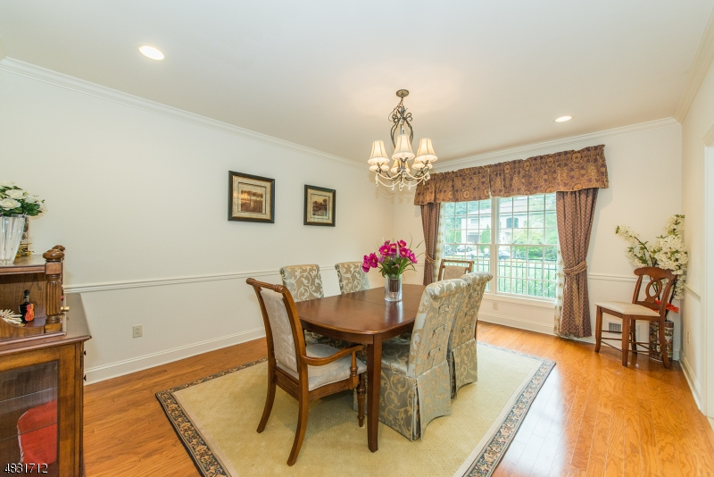 The beautiful large formal dining room features gleaming hardwood floors!
