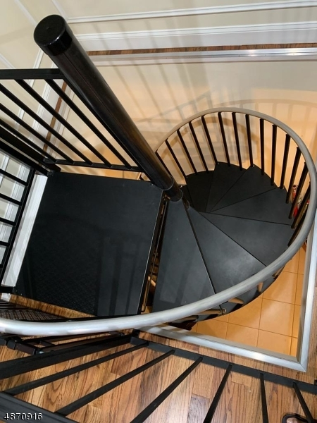 Spiral Stairs from first unit leading to full rec room