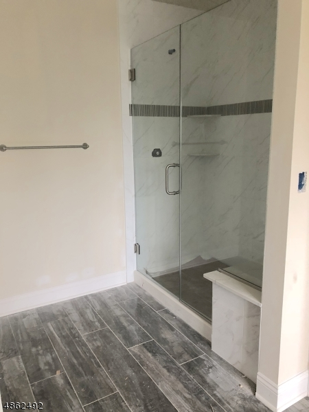Beautifully upgraded Tile and Oversized shower with Built-In Seat