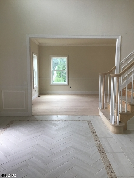 Beautiful 2 Story Entrance. Formal Living Room to the left and 5th bedroom/study on the right.
