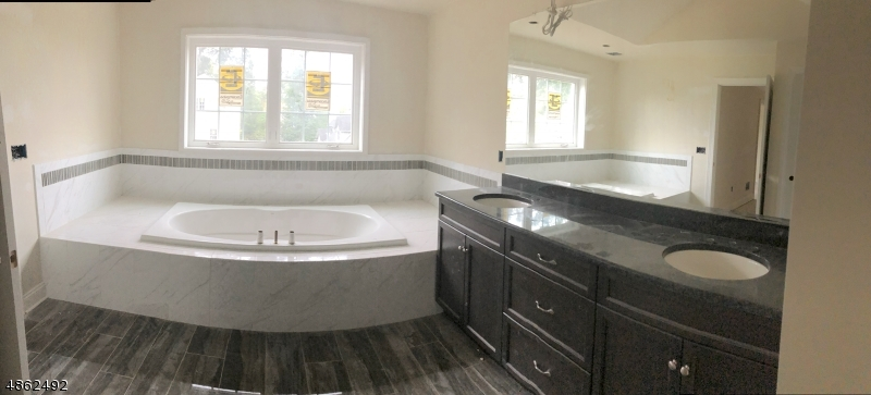 Panaramic View of Bath with soaking tub, double sink vanity and Separate Shower
