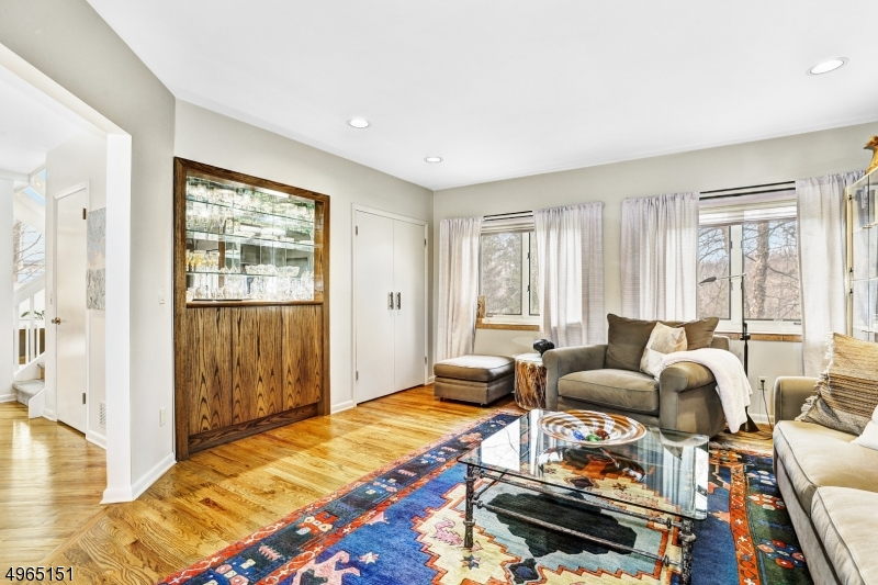 Located next to master bedroom suite. Wood floors, double closet, built-in bar with cabinetry for storage.