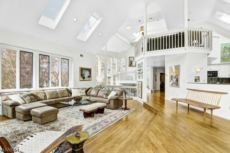 Open floor plan and two story ceiling height. Wood floors. Skylights.