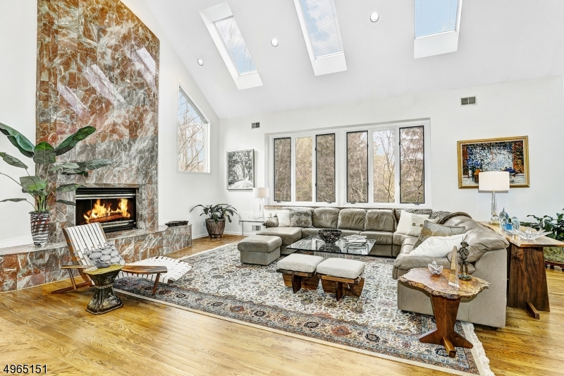 Floor to ceiling marble gas fireplace.