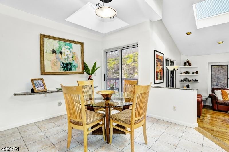 Eat-in kitchen breakfast room with sliding glass door to deck.