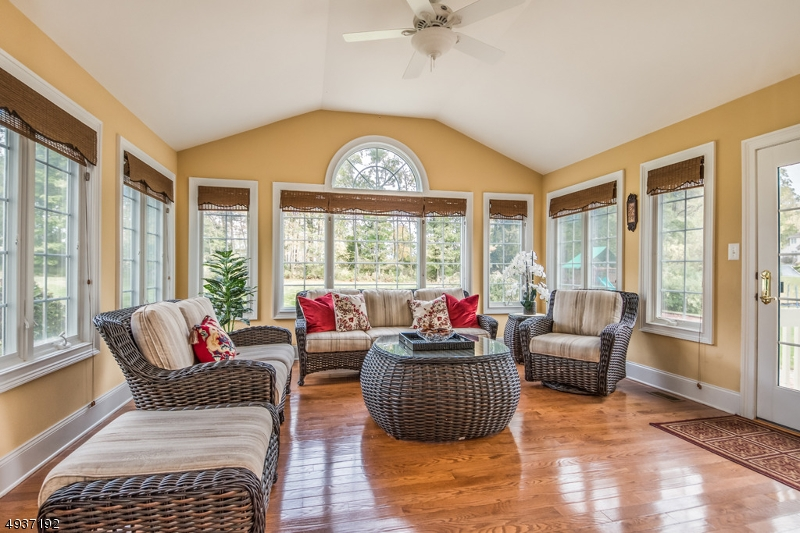 Gorgeous sun drenched Sunroom with nature views!