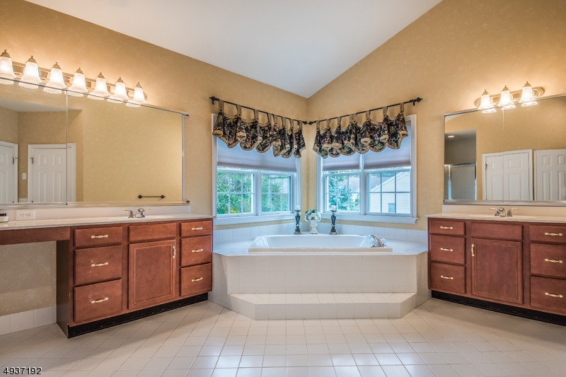 Jetted tub, stall shower, linen closet, double vanities, 2 walk-in closets!