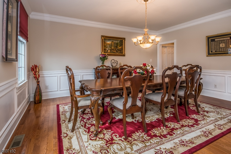Stunning spacious Dining Room with hardwood flooring