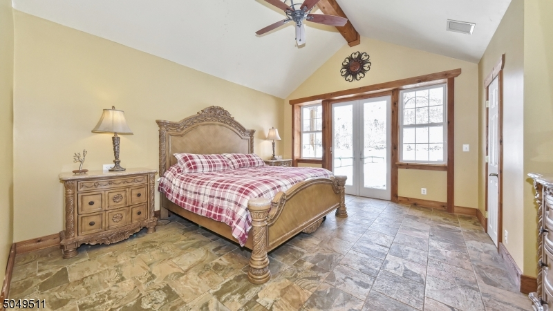 Cathedral ceiling, french door to private patio overlooking lake and mountain views.