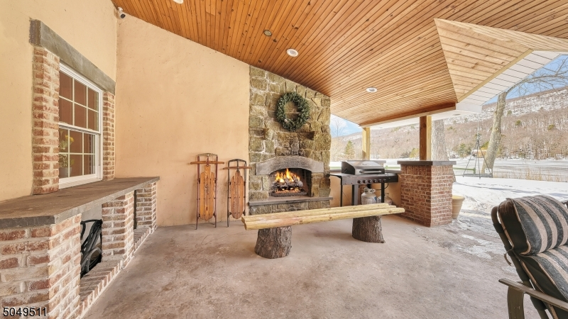 Access from kitchen and family room. Wood burning fireplace. Vaulted ceiling with recessed lighting.