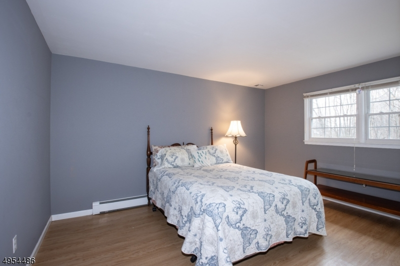 Generously-sized Bedroom on Lower Level, with Access to Family Room, Full Bath, Laundry Room and Garage.