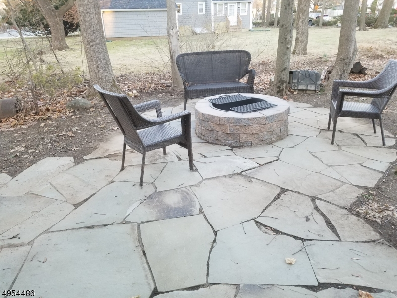 Rear Stone Patio Area with Built-In Fire Pit.