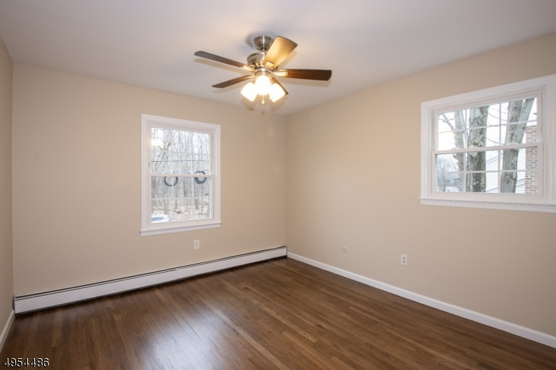 Spacious Bedroom with Double Closet and Newly Refinished Hardwood Flooring.