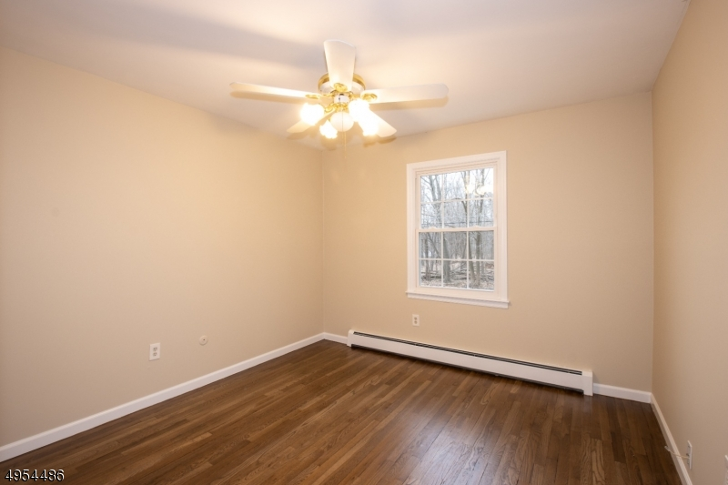 Large Bedroom With Double Closet and Newly Refinished Hardwood Flooring.