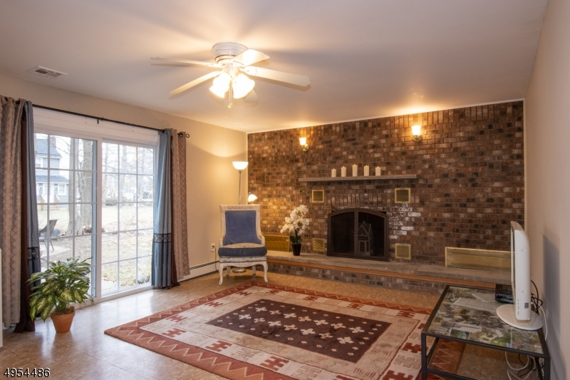 Inviting Family Room with Brick Wall and Sliders to Patio.