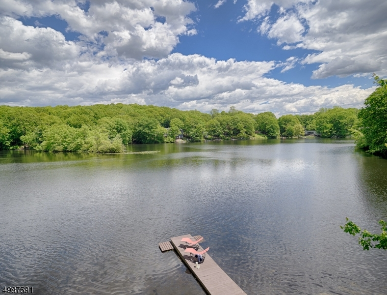Located on Crystal Lake, the most scenic lake in town. The home offers  easy access to the Tourne County Park with over 500 acres of hiking trails  just steps away.  Location....Location!