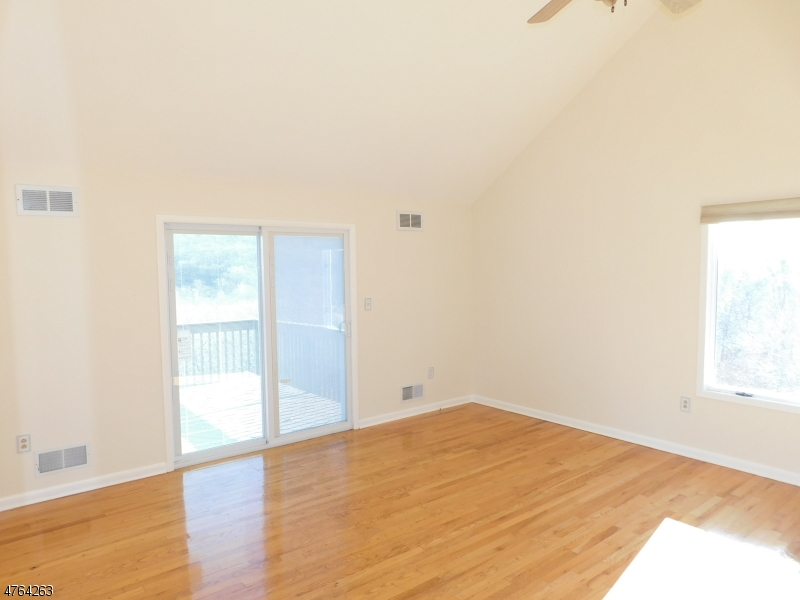 With Full Bath, Walk in Closet, a Vaulted Ceiling,and Deck Access