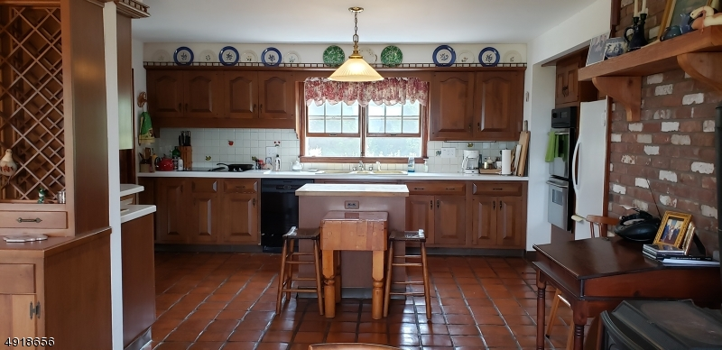 Country Kitchen with hand made terra cotta floor tiles.