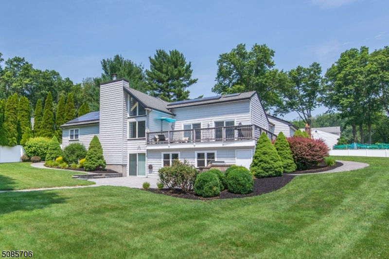 You can see here the plush property, professionally landscaped. Gorgeous home inside and out!
