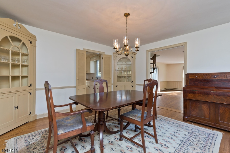 This large Dining Room sits between the Kitchen and Family Room. If you prefer this would be ideal space to open the wall for an enormous new kitchen design.