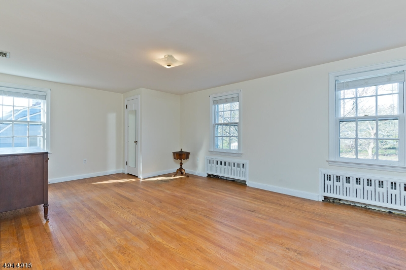 The Master Bedroom has plenty of space and light.