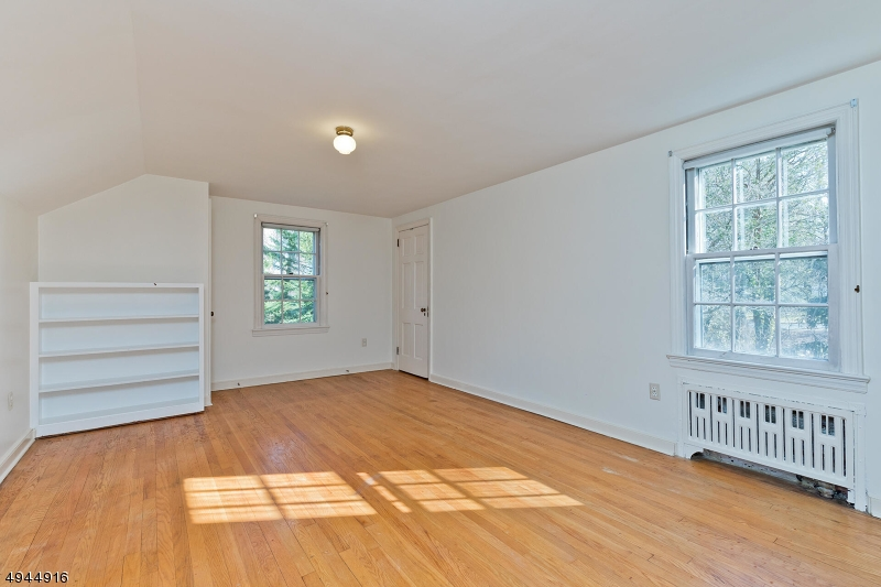 This bedroom is apart from the others, and would make a nice guest bedroom.
