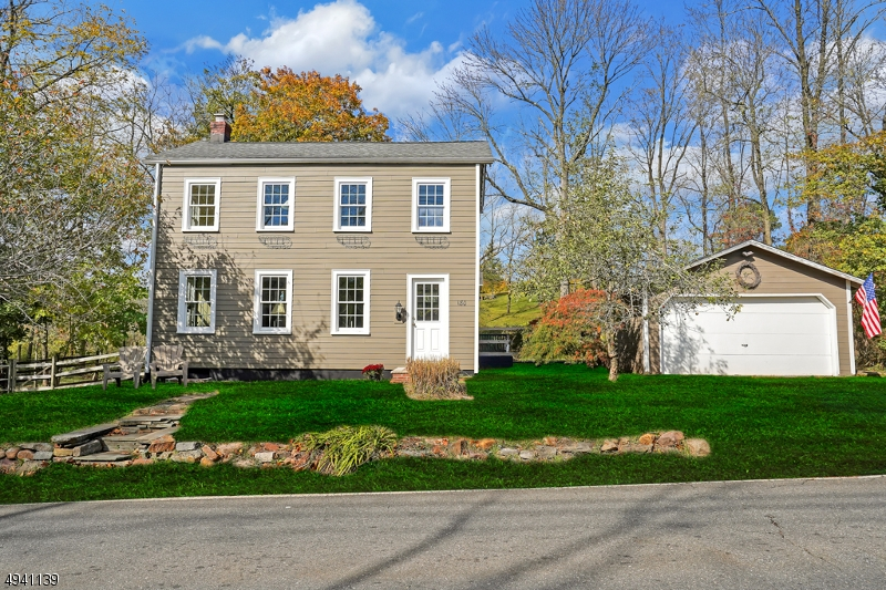 This smarly-renovated, vintage, two-story home sits up high along quaint and historic, Blackwell's Mills Road on a gorgeous and level parcel.