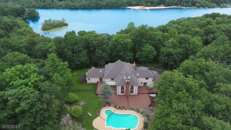 Located on the West Shore with seasonal views of the lake, this home was custom designed and built with high quality materials and lovingly maintained by the current original owner.