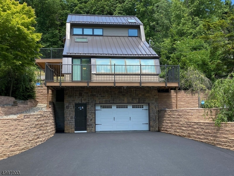 Amazing Contemporary with Allen Block Retaining Walls, Decorative Garage Hardware and Brand New Paved Driveway.