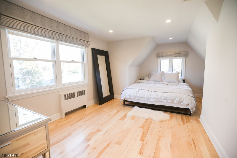with walk-in closet and master bath with stall shower