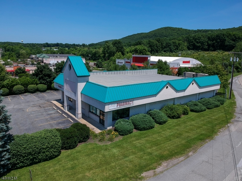 31 PARKING SPACES, BUILDING WAS CUSTOM BUILT & DESIGNED FOR TWO SEPARATE UNITS , BUILDING ALREADY HAS TWO SEPARATE ELECTRIC METERS & TWO NATURAL GAS METERS, FINISHED BASEMENT OFFERS OPTIONS FOR MORE OFFICE , PROFESSIONAL / RETAIL / STORAGE , EQUIPMENT