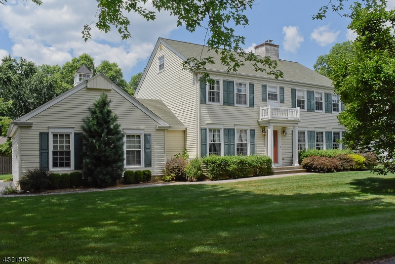 Majestic curb appeal on impressive wide lot.
