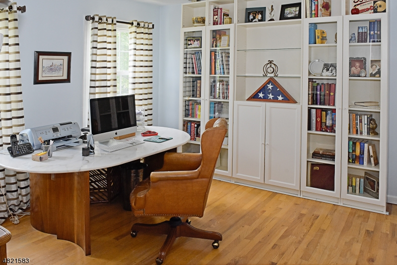 Currently used as office. Custom wall shelving,cabinetry