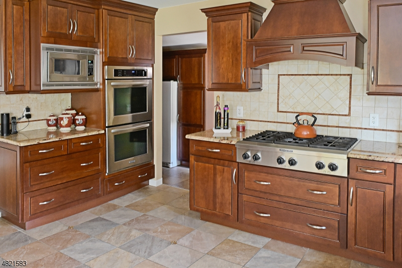 Double wall oven, open to Mud Room with fabulous pantry section and separate freezer