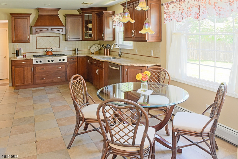 Premium grade cabinetry, granite counters, distinctive wood hood, separate breakfast area surrounded by windows and open to Family Room